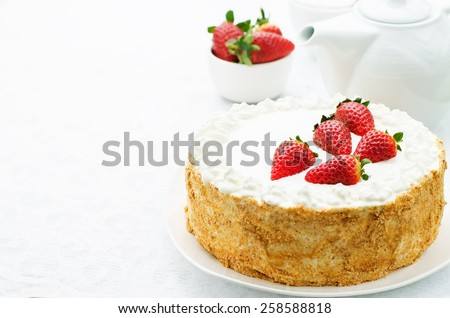 cake with cream and strawberries on a white background. tinting. selective focus - stock photo