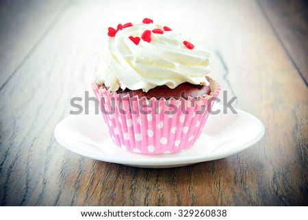 Cake with Cream, Cupcake on Woody Background.