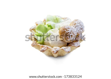 Cake with cream mushrooms and sugar powder isolated over white