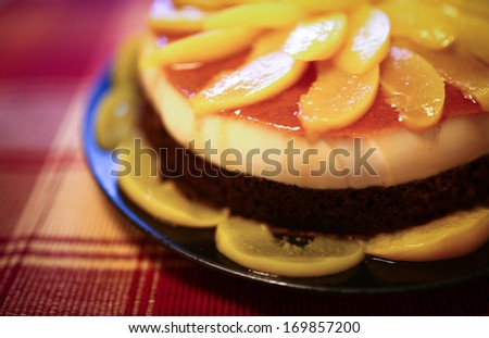 Cake with dark chocolate and peach mousse, and are decorated with slices of peaches on top