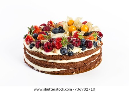 cake with fresh berries on white background
