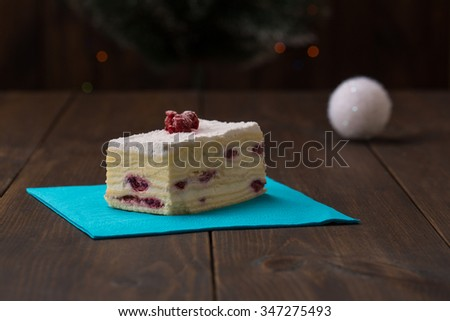 cake with fresh cherry on wooden background,