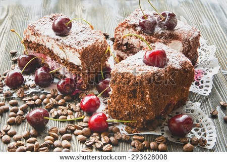 cake with grated chocolate, cherry and coffee beans close