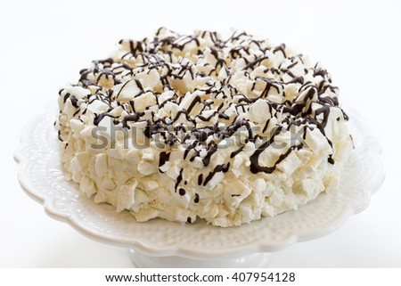 cake with ice cream covered with meringue and chocolate - stock photo