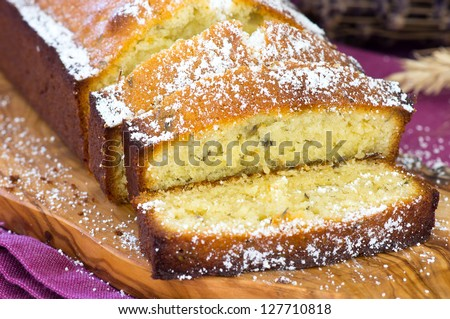 Cake with lavender flowers and white chocolate, decorated - stock photo