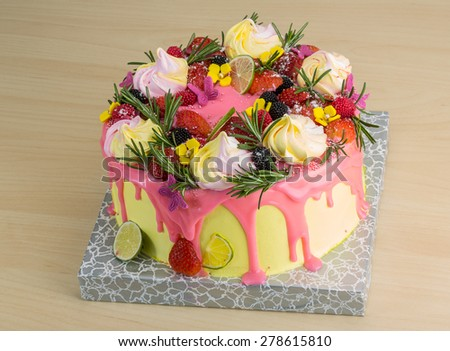 Cake with meringue and strawberries, lime, rosemary - stock photo