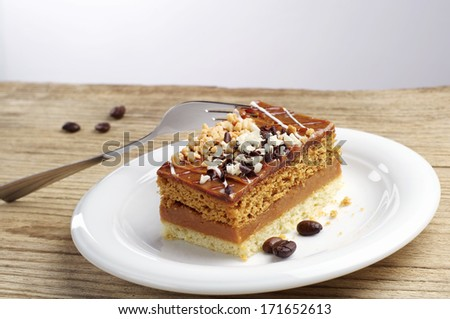 Cake with nuts and chocolate on wooden table