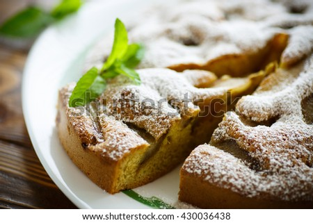 cake with pears in powdered sugar - stock photo