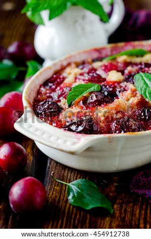 Cake with plums and caramel - stock photo