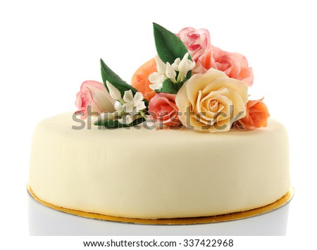 Cake with sugar paste flowers, isolated on white - stock photo
