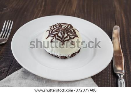 Cake with white and dark chocolate - stock photo