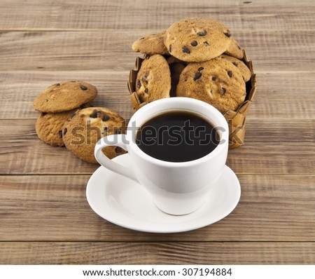 cakes and cup on a wooden background - stock photo