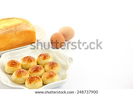 Cakes and eggs on white background. - stock photo