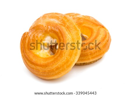 cakes eclairs on a white background
