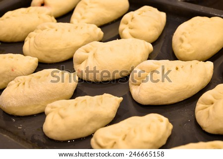 Cakes on a tray in the oven - stock photo