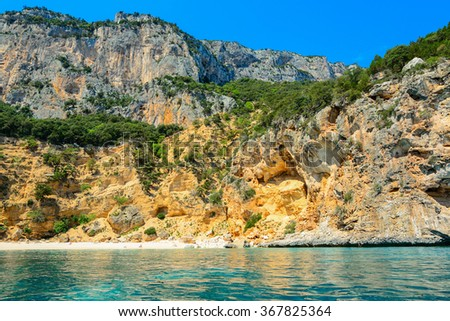 Cala Biriola seen from the water, Sardinia - stock photo