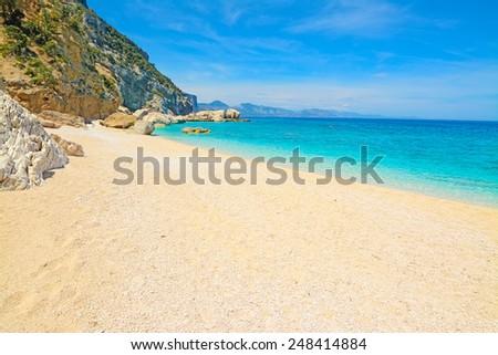 Cala Biriola shore on a clear day. Shot in Sardinia, Italy - stock photo