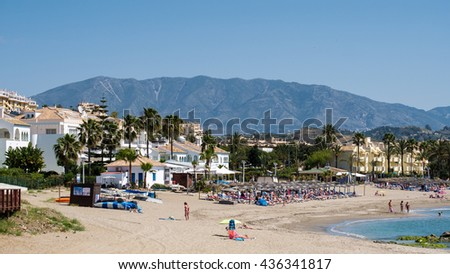 CALA DE MIJAS, ANDALUCIA/SPAIN - MAY 27: View along the Beach to Cala de Mijas Spain on May 27, 2016. Unidentified people