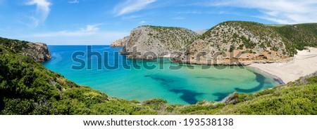Cala Domestica beach and promontory, isolated and wild beach along the west coast of Sardinia, Buggerru, Italy - stock photo