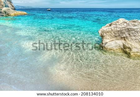 Cala Mariolu in hdr tonemapping, Sardinia - stock photo
