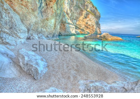 Cala Mariolu rocks by the sea. Hdr tone mapping effect - stock photo