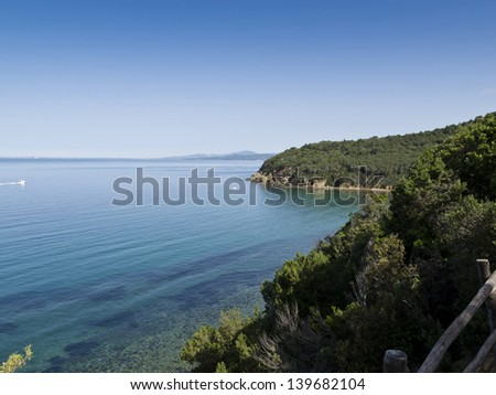 Cala Martina beach, in the background the coast of the city of Follonica, Tuscany, Italy