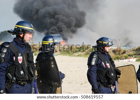Calais - October 27, 2016: Police try to keep control in the Jungle of Calais during the eviction of the illegal refugee camp in the north of French