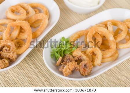 Calamari - Deep-fried squid rings served with garlic mayo. - stock photo