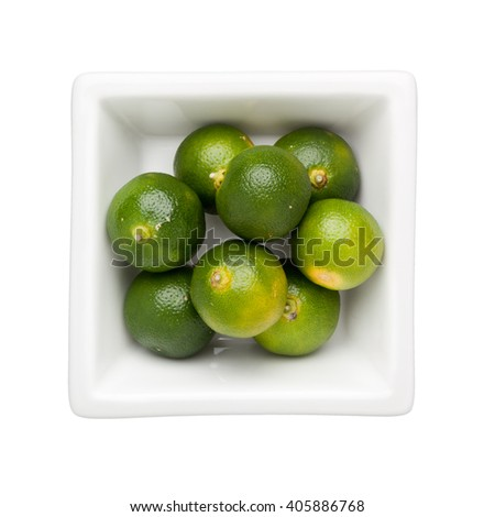 Calamondin fruits in a square bowl isolated on white background - stock photo