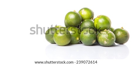 Calamondin or calamansi lime over white background