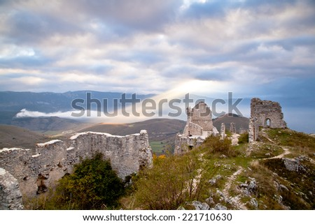 Calascio (L'Aquila) Italy: Scenery view of castle of Calascio at sunrise with a stunning sky - stock photo