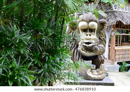 CALAUAN, LAGUNA, PHILIPPINES - AUGUST 28, 2016: Huge concrete carved monkey statue in an Asian aquatic jungle theme park