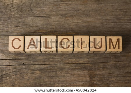 CALCIUM word written on wooden cubes - stock photo
