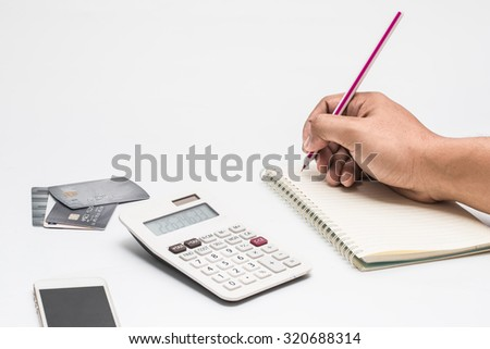 Calculated that the cost or expenses with a credit card. - stock photo