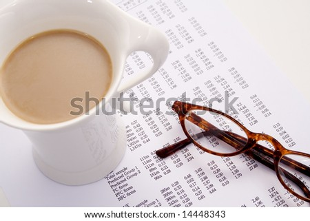 Calculating finances and bills with coffee and glasses