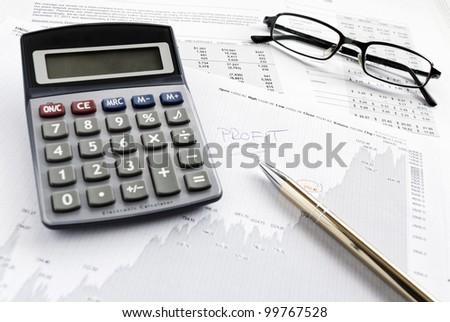 Calculating financials. Creating financial report. - stock photo