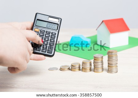 Calculating the cost of home insurance or car. - stock photo
