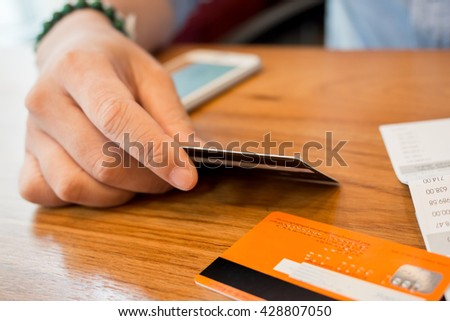 calculating the credit card  - credit card debt payments  - stock photo