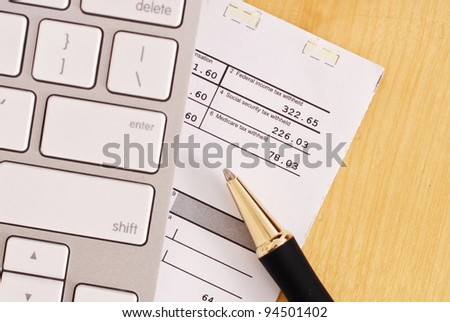 Calculating Your Tax Return - stock photo