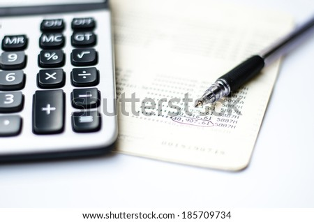 Calculations and account book and pen