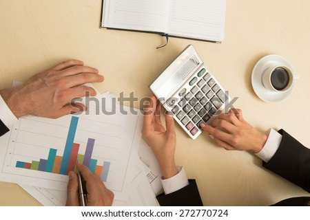 Calculations of business project. Graph of annual budget. - stock photo