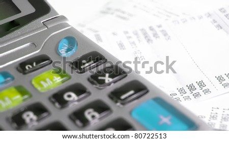 Calculator and bill - stock photo