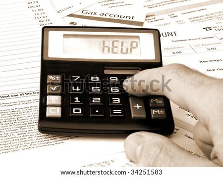 Calculator and Bills - HELP - stock photo