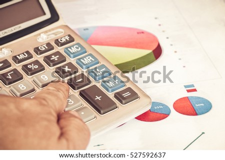 calculator and business diagram document with vintage tone