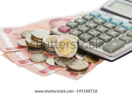 Calculator and coins on thai banknotes