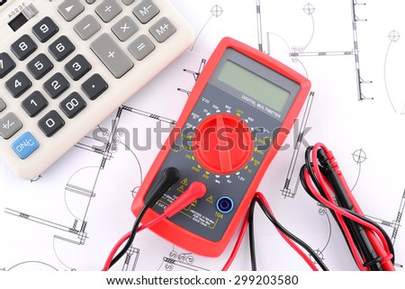 calculator and Digital multimeter on plans