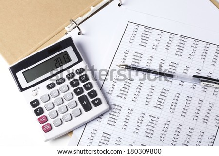 Calculator and documents on the table - stock photo