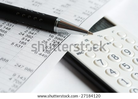 Calculator and financial data analyzing. - stock photo