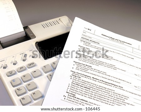 Calculator and IRS tax form.
