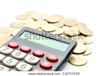 Calculator and japanese coin - stock photo